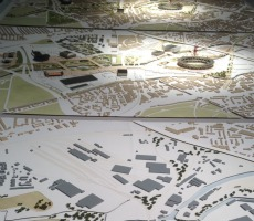 A model of the Olympic area in three sections, before, during and in the future