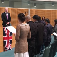 New Britons pledge allegiance to the Queen at a Brent citizenship ceremony, January 2016