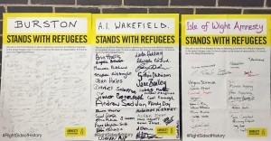 Supporters from around the country sign placards for the march. Picture: Sara Rydkvist, Amnesty International UK