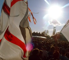 People wave the English flag at Glastonbury music festival. Photo: Stew Dean